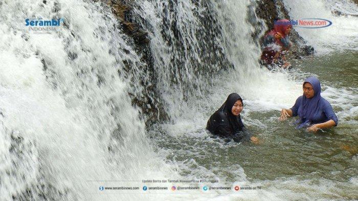 FOTO - Air Terjun Rayap Destinasi Wisata di Aceh Utara Yang Kembali Ramai Dikunjungi - air-terjun-rayap-di-aceh-utara-4.jpg