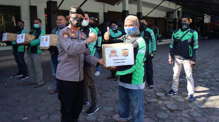Ditlantas dan Ditpamobvit Polda Aceh Bakti Sosial dengan Puluhan Tukang Ojol