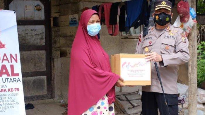 Polres Aceh Utara Salurkan Paket Bantuan Sosial ke Masyarakat Kurang Mampu