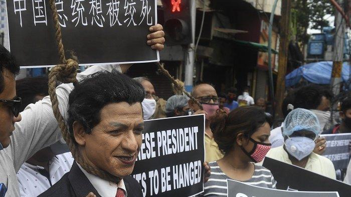 Marah Dengan China, Pendemo India yang Bingung Malah Bakar Patung Kim Jong Un