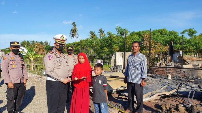 Dirlantas Polda Aceh Beri Bantuan untuk Korban Kebakaran di Peukan Bada, Aceh Besar