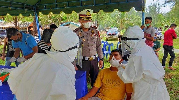Ditlantas Test Swab Antigen Pengunjung Wisata Pantai Lampuuk dan Pantai Kuala Aceh Besar