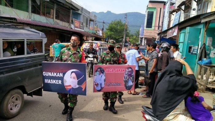 TNI Ajak Masyarakat Agara Terapkan Protkes Covid-19, Bagikan Ratusan Masker