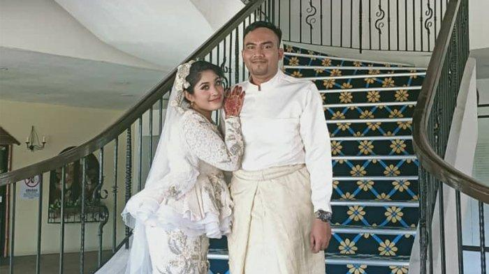 Harris bin Terry Sarava dan isterinya Siti Raedela Saffia.