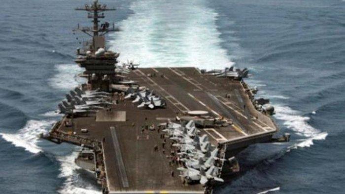 Kapal Induk USS Theodore Roosevelt saat dikirim ke Teluk Persia untuk mengawasi kemungkinan Iran mengirimkan senjata ke Yaman.