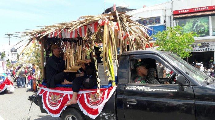 FOTO-FOTO: Rumah Adat Papua Hingga Batak Meriahkan Karnaval Banda Aceh - kemeriahan-karnaval-2_20170819_131024.jpg