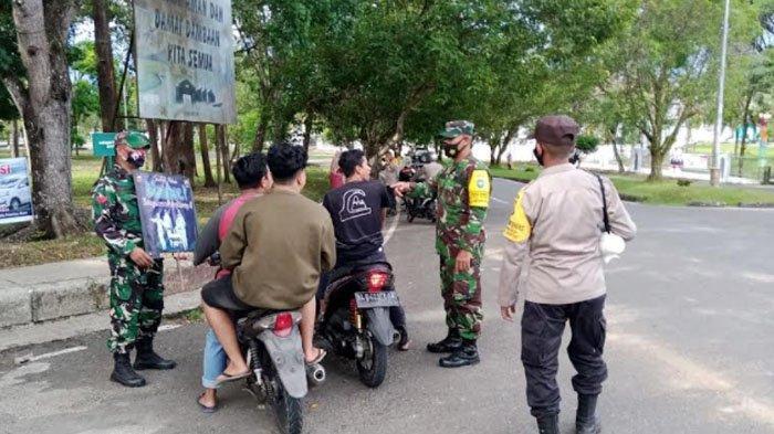 Cegah Covid-19, Petugas Gabungan TNI-Polri Gelar Razia Masker