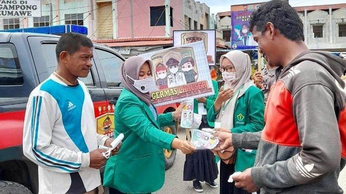 Mahasiswa Unimal dan Polisi Sosialisasikan Penggunaan Masker