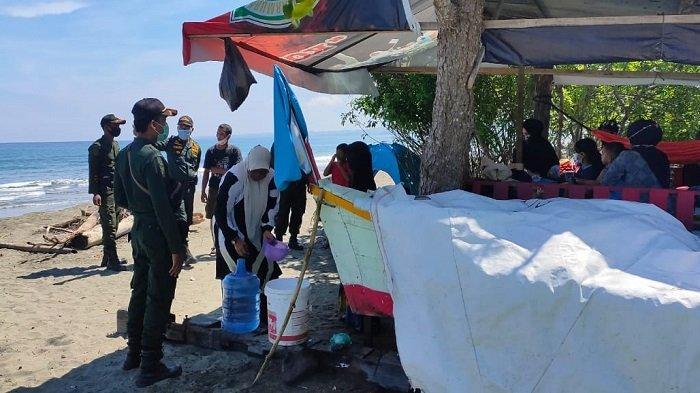 Satpol PP Razia Masker di Pantai Ujong Kareung, 20 Pengunjung Terjaring