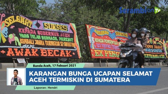 Sejumlah karangan bunga terpajang di badan jalan depan Kantor Gubernur Aceh, Rabu (17/2/2021).  Karangan bunga itu berisi ucapan 'selamat atas prestasi Aceh' yang menjadi provinsi termiskin di Sumatera.