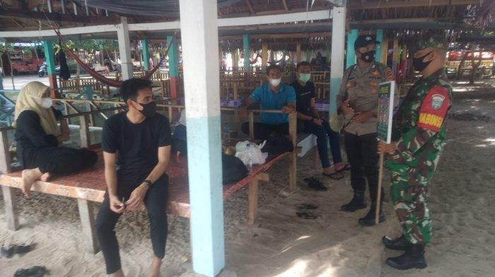 Polisi Imbau Pengunjung Lokasi Wisata Pasir Putih Patuhi Protokol Kesehatan