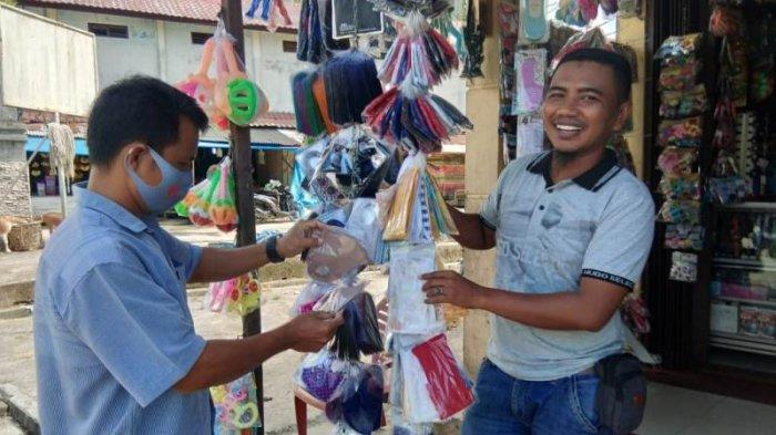Penjualan Perlengkapan Sekolah di Simeulue Menurun Drastis, Pedagang di Pajak Inpres Jual Masker