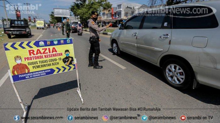 FOTO - Puluhan Pengendara Terjaring Razia Busana Muslim dan Protokol Kesehatan di Lampeuneuruet - polisi-melakukan-protokol-kesehatan-1.jpg