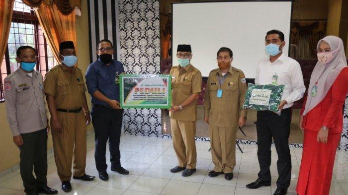Bank Aceh Syariah Cabang Kutacane Salurkan Paket Sembako dan Masker untuk Penanganan Covid-19