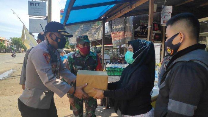 Satgas Operasi Yustisi Bagi 170 Paket Sembako Untuk Masyarakat
