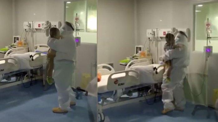 Bocah Suspect Covid-19 Menangis Mencari Ibunya, Petugas Medis Memeluk Untuk Menenangkannya