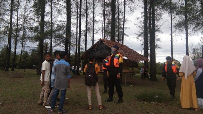 Brimob Polda Aceh Ajak Pengunjung Objek Wisata di Nagan Raya Patuhi Protkes Covid-19
