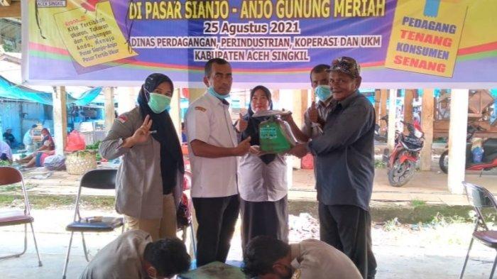 Disperindagkop Aceh Singkil Gelar Sidang Tera Ulang Timbangan di Pasar
