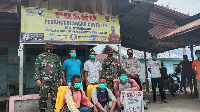 TNI Bersinergi Bersama Masyarakat, Membangun Posko Covid-19 di Desa