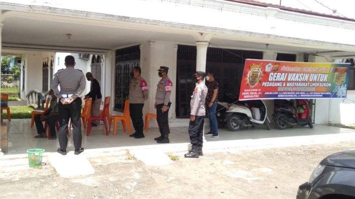 Satuan Reskrim Polres Aceh UtaraGelar Vaksinasi Massaldi Pasar Terpadu