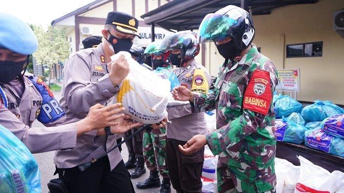 Polres Pidie Bantu 300 Paket Sembako untuk Warga Berdampak PPKM Mikro