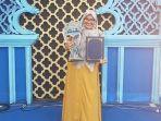 adila-lathifa-qariah-asal-aceh-besar-juara-mtq-antar-bangsa-dmdi-2019.jpg
