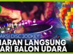 aksi-disc-jockey-memainkan-musik-secara-langsung-dari-balon-udara.jpg