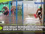 aksi-pemuda-nekat-berenang-di-genangan-banjir.jpg