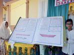 alquran-akbar-yang-ditulis-tangan-oleh-syaikh-hamdan-rusli-ar-ramat_20171121_111857.jpg