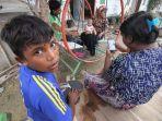 ara-rohingya-bersantai-di-shelter-desa-blang-adoe_20161125_085107.jpg