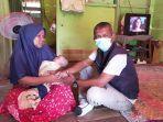 bantuan-kepada-nurmi-ibu-dari-bayi-kelainan-jantung-di-desa-titi-baro-kecamatan-idi-rayeuk.jpg