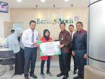 direktur-utama-bank-aceh-syariah-haizir-sulaiman_20181016_094234.jpg