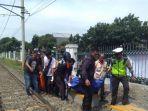 dua-karyawan-pt-kereta-api-indonesia-kai-tewas-tersambar-kereta-api.jpg