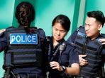 ilustrasi-polisi-singapura.jpg