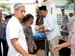 jamaah-ibadah-shalat-jumat-masjid-alfalah-sigli-bagikan-makanan-gratis.jpg