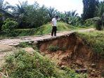 jembatan-terancam-roboh-di-aceh-tamiang-21022021.jpg