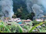 kebulan-asap-dari-sejumlah-bangunan-yang-dibakar-kkb-di-distrik-kiwirok-papua.jpg