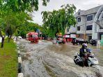kondisi-jalan-t-nyak-makam-lampineung-saat-banjir-melanda-wilayah-banda-aceh.jpg