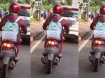 kreatifitas-ibu-hamil-saat-berkendara-sepeda-motor-sendirian.jpg