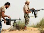 milisi-bersenjata-libya-bisa-melakukan-jual-beli-senjata-lewat-media-sosial_20180614_210555.jpg