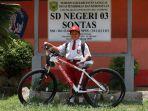 nursaka-8-saat-menerima-hadiah-sepeda-dari-presiden-joko-widodo_20180916_152024.jpg