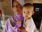 nursyidah-mengendong-anaknya-muhammad-al-zafran_20180820_084831.jpg