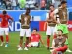 para-pemain-inggris-tampak-lesu-seusai-kalah-dari-belgia_20180715_103230.jpg
