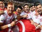 para-pemain-timnas-tunisia-merayakan-keberhasilan-lolos-ke-putaran-final-piala-dunia_20171112_112035.jpg