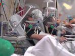 pasien-covid-19-mengenakan-helm-gelembung.jpg