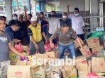 pedagang-kedai-runcit-aceh-di-malaysia-bagi-bantuan.jpg
