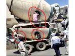 pekerja-imigran-india-keluar-dari-dalam-perut-mixer-truk-semen.jpg