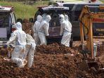 pekerja-menguburkan-jenazah-korban-covid-19.jpg