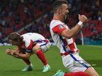 pemain-depan-kroasia-ivan-perisic-merayakan-setelah-mencetak-gol-ketiga-di-euro-2020.jpg