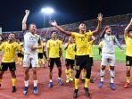 pemain-timnas-malaysia-merayakan-kelolosan-ke-babak-final-piala-aff-2018.jpg